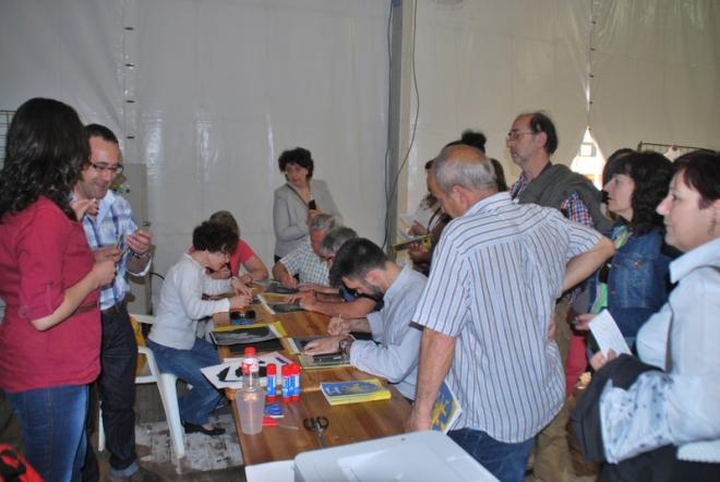 Taller en vivo del área de pintura de Herencia durante la Fiesta del Participante en Ciudad Real